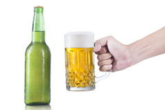 Closeup of hand taking glass of beer Stock Photo