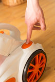 Closeup of a hand to turn on the vacuum cleaner. Man is unrecogn Royalty Free Stock Photo