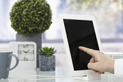 Closeup hand touching tablet screen Royalty Free Stock Images