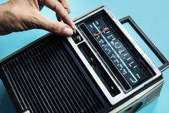Closeup of hand tuning classic retro radio transistor Stock Images