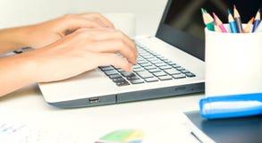 Closeup hand typing on keyboard laptop Stock Photo