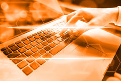Closeup of hand using computer keyboard. Closeup of businesswoma. N hand using computer laptop keyboard Royalty Free Stock Photography