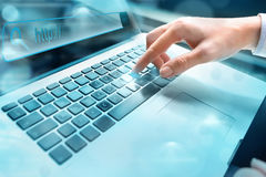 Closeup of hand using computer keyboard. Closeup of businesswoma. N hand using computer laptop keyboard with written in search bar on virtual screen Stock Image
