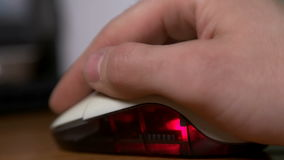 Closeup of a hand using a computer mouse stock footage