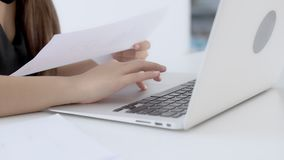 Closeup hand woman working and typing with laptop at office stock video