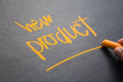New Product. Closeup hand write a topic New Product on chalkboard Stock Photography
