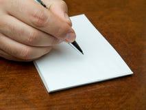 Closeup hand writing blank memo book Stock Photography