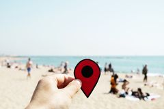 Man with a red marker in La Barceloneta beach stock images