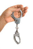 Closeup Handcuffs with hand Royalty Free Stock Images