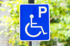 Closeup of handicapped parking place sign Royalty Free Stock Image