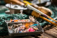 Closeup of handmade angler equipment with rods and fishing flies. Retro style stock image