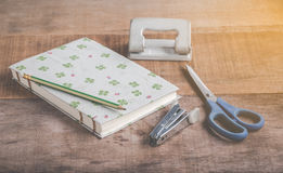 Closeup of handmade book and old accessories on wooden backgroun Stock Image