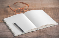 Closeup of handmade book and pen on wooden background Stock Image