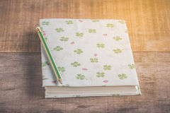Closeup of handmade book and pencil on wooden background Stock Photo