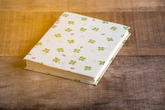 Closeup of handmade book on wooden background Stock Image