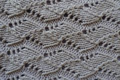 Closeup of handmade knitted grey openwork Royalty Free Stock Images