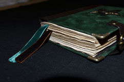 Closeup of handmade notebook with emerald and brown bookmarks Royalty Free Stock Photography