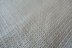 Closeup of handmade plain white stockinette stitch knitwork. Close up of handmade plain white stockinette stitch knitwork Royalty Free Stock Image
