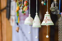 Closeup on handmade traditional ceramic jingle bells with ethnic ornament. Handmade traditional ceramic jingle bells with ethnic ornament Stock Photo