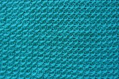 Closeup of handmade turquoise knitwork from above. Close up of handmade turquoise knitwork from above Royalty Free Stock Photos