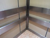 Handrail stainless wall protection systems in lift. Closeup Handrail stainless wall protection in lift systems interior royalty free stock images