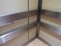 Handrail stainless wall protection systems in lift. Closeup Handrail stainless wall protection systems royalty free stock photo