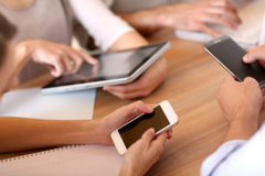 Closeup of hands of business people using tablets Royalty Free Stock Images