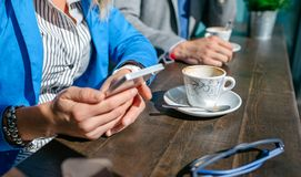 Hands of business woman and man having coffee royalty free stock photo