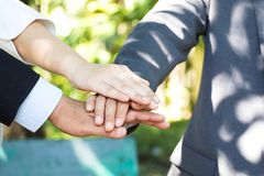 Closeup hands of businessman and businesswoman. Holding together Stock Photo
