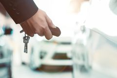 Closeup of hands of a businesswoman Using a remote control car key. Closeup photo of a businesswoman hand Using the remote control to open the car door royalty free stock photography