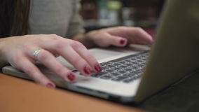 Closeup hands. Businesswoman working on laptop in modern cafe 4k. Closeup hands Businesswoman working on laptop in modern cafe 4k stock video