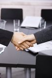 Businesswomen shaking hands over table Royalty Free Stock Photos