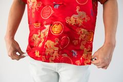 No more Ang Pao money envelope. Closeup hands of Chinese man with red traditional cheongsam costume pull long pant pockets to show no more Ang pao envelope or Stock Photography