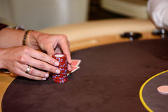 Closeup of hands with chips on poker table, selective focus. Closeup of hands with chips on poker table Royalty Free Stock Photo