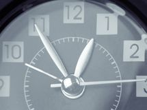 Clock hands. Closeup of hands on clock face Royalty Free Stock Images