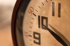 Closeup of hands on clock face Stock Photos