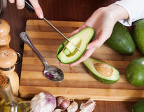 Closeup of  hands cooking with avocado Royalty Free Stock Image