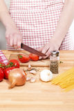 Closeup of hands cutting tomatoes Stock Images