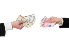 Closeup of hands with dollar and euro Royalty Free Stock Images