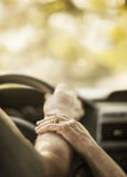 Closeup hands elderly person by car Stock Images