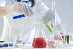 Closeup of Hands of Female Laboratory Staff Working With Liquids Specimens in Flasks Royalty Free Stock Photos
