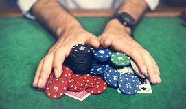 Closeup of hands with gambling tokens and card stock photography