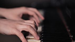 Closeup of the hands of a girl playing the piano instrument keyboard musician. Pianist sound concert.  stock video