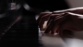Closeup of the hands of a girl playing the piano instrument keyboard musician. Pianist sound concert.  stock video footage