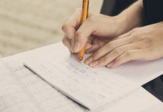Closeup of hands of girl studying for universitet exam. Stock Photography