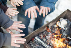 Closeup of Hands of The Group of People Standing Together Near Bonfire Royalty Free Stock Images