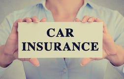 Closeup hands holding card sign car insurance text message. Closeup businesswoman hands holding white card sign with car insurance text message isolated on grey stock photo