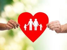 Closeup of hands holding red heart with family Royalty Free Stock Photos