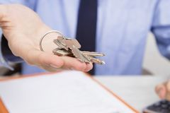 Closeup of hands with keys of house royalty free stock photo
