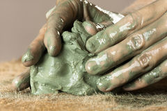 Closeup of hands kneading blue clay Royalty Free Stock Photography